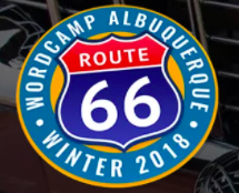 A classic route 66 road sign post surrounded by a blue circle tht says WordCamp Albuquerque Winter 2018